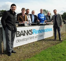 Colin Anderson, director of Banks Renewables (front) shakes hands with a club official to seal the sponsorship deal