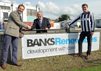 Banks Renewables director Colin Anderson (left) and colleague Callum Whiteford (left) with a club official