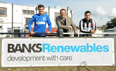 Banks Renewables Director Colin Anderson (centre) with colleagues (from left) Callum Whiteford and Ryan Newall at the Cumnock Juniors ground