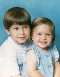 Craig aged two with his sister