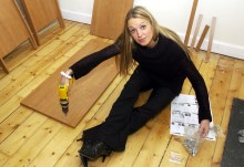 A woman with Ikea-style flat pack furniture