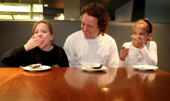 Celebrity chef Tom Kitchin with two children learning about cooking