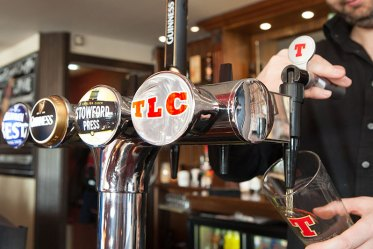 TLC on tap - a barman pours a pint of TLC