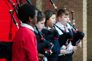 Children playing bagpipes