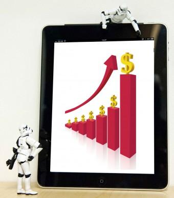 An upward trending sales graph shown on an iPad
