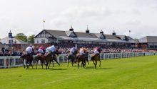Jockeys racing at Musselburgh Racecourse