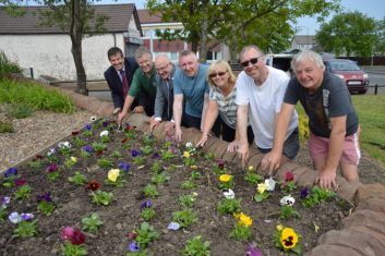 Image of Banks Group Community funded garden. Pictured; Mark Dowdall, Vic, Cllr David Dodds, Tommy McCafferty, Betty Currie, Ian Currie and Alan Cunningham