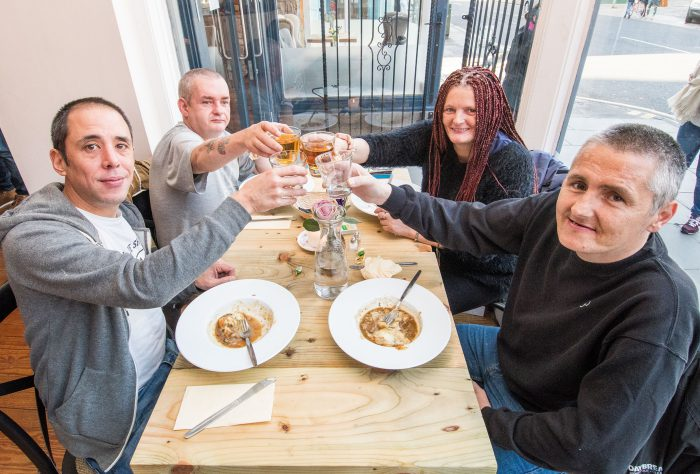 "Photographer Ian Georgeson, 07921 567360 Pic: Back left - James Sutherland Front left - Daryn Sabiston Back right - Michelle Dounie Front right - Sean Macinnes Restaurant Welcomes First Homeless Guests to Dine in Style Homeless people in Edinburgh have today (Mon) been treated to a fine dining meal at a chic new restaurant for the first time. Maison Bleue at Home opened in Edinburgh to a fanfare of praise just two weeks ago with a promise to feed members of the homeless community once a week, while also contributing its profits to charity. Now, the Queensferry Street eatery -run by renowned father and daughter restaurateurs Dean and Layla Gassabi - has debuted its special meal service, made possible by ""pay it forward"" contributions from diners. Guests were treated to a choice of venison haunch casserole with Mouselline cheesy mash or a wild mushroom penne pasta dish, followed by apple and red berry crumble with vanilla ice cream. Those taking part were selected by three homeless charities, Social Bite, Crisis and The Big Issue and booked their places through Social Bite cafes. They dined in small groups, accompanied by volunteers. Diner Michelle Dounie said: ""The staff were great and the food was amazing – I would easily give it five stars. We were even given food to take away aswell, which was just superb. ""The atmosphere was perfect too, really calm. You would never think that you were sitting with homeless people having a meal. I was with my partner and it just felt like my partner had taken me out for a lovely dinner."" Fellow diner, Natalie Mullen, commented: ""I really enjoyed it my first experience at the restaurant. ""It was good to come along, get out of the cold and enjoy a hot meal in the company of other folk who are in the same situation. I would definitely recommend it to others."" The restaurant is staffed, run and designed by the Maison Bleue team and for this venture, they are working in partnership with Josh Littlejohn of the Social Bite sandwich chain, a social enterprise which supports homeless people. Layla said: ""It's wonderful that Maison Bleue now has the opportunity to give something back to the homeless community and, in the process, donate profits to charities that are very close to our hearts. ""Our first sitting for homeless guests was a fantastic success. We were determined to make sure everyone really enjoyed the experience and that our guests received the same quality of service and delicious home-cooked meals as all our customers do. ""The feedback has been fantastic. Everybody really enjoyed it and we are excited to now begin this initiative on a weekly basis."" Matt Kelly, Manager of Maison Bleue at Home, added: ""Our aim is to help combat homelessness by providing those less fortunate with a nutritious and filling meal in a relaxed, friendly and safe environment – which is exactly what we have done today. ""The generosity of diners as part of our 'pay it forward' scheme has been very heartening and we hope the service was beneficial for those who came along."" Since opening its doors the restaurant has been a hit with diners impressed by Maison Bleue's hallmark eclectic mix of Scottish and French-inspired cuisine, with many making taking the chance to make ""pay it forward"" contributions. The sittings for homeless guests will run weekly on a Monday from 3-5pm and will see 50 guests enjoy a choice of two freshly cooked courses and dessert, which have been specially selected to provide a hearty meal for vulnerable members of society. Places can be booked through the Social Bite cafes. Josh Littlejohn sees the restaurant's social enterprise ethos as a natural evolution of the Social Bite chain which he founded. The ""sandwich shops with a difference"" use a similar pay it forward model to provide food for homeless people. Meanwhile one in four of Social Bite's staff were formerly homeless. Josh added: ""We want the Monday meal services to be an opportunity for the homeless community to eat with dignity - not to offer a handout but a hand up - to employment, stability and self-worth. ""It's a natural evolution of what we've been doing at Social Bite and it's fantastic to see people are getting on board and supporting us in the same way."" Maison Bleue at Home will be giving 100% of its profits to charity – 50% directly to Social Bite and 50% to other good causes chosen by staff. The restaurant will also provide a training and employment programmes for members of the Social Bite Academy, a four-year paid course for homeless people. The venture is backed by an impressive list of prominent names from the Scottish restaurant scene. Along with Dean and Josh, other board members including David Wither of the Montpelier Group, restaurateur Simon Littlejohn and Michelin-starred chef Martin Wishart. For more information and to book, please visit: www.home-restaurant.co.uk ENDS Issued on behalf of Maison Bleue by Holyrood PR, 0131 561 2244 or info@holyroodpr.co.uk"