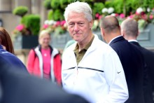 Former president Bill Clinton stopped the crowds in Princes Street, Edinburgh, as he emerged from the five star Balmoral Hotel dressed for a game of golf. Moments before he emerged, Secret Service staff loaded golf clubs into his vehicle.