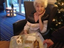 Resident at Bupa Care Home with her Gingerbread House