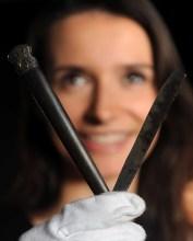 Woman with cut throat razor