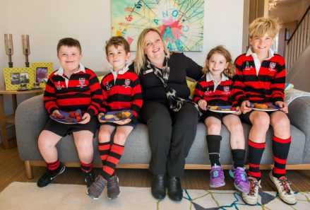 PR Photos of CALA Sales Advisor Debby Thomson cuts the ribbon to open Law Gardens showhomes with James Lindsay (11), Blair Donachie (6), Lily Muir (4), Dylan Muir (6) and coaches from North Berwick mini Rugby team