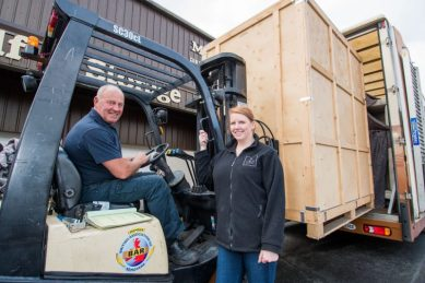 PR Photos of Claire McLoughlin, Marketing Assistant at CALA Homes (East) and Archie Purdie, director of Purdie Worldwide Removals and Storage, helps load up items from there showhomes which they are donating to a flat connected to the Royal which will be used for families wanting to stay near by and visit patients.