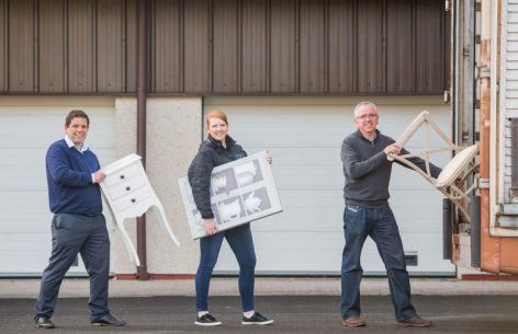 PR Photos of Claire McLoughlin, Marketing Assistant at CALA Homes (East), Keih Robertson, Director at Fresh Start and Stewart Ferguson, Operations Manager at Fresh Start helping to carry furniture.