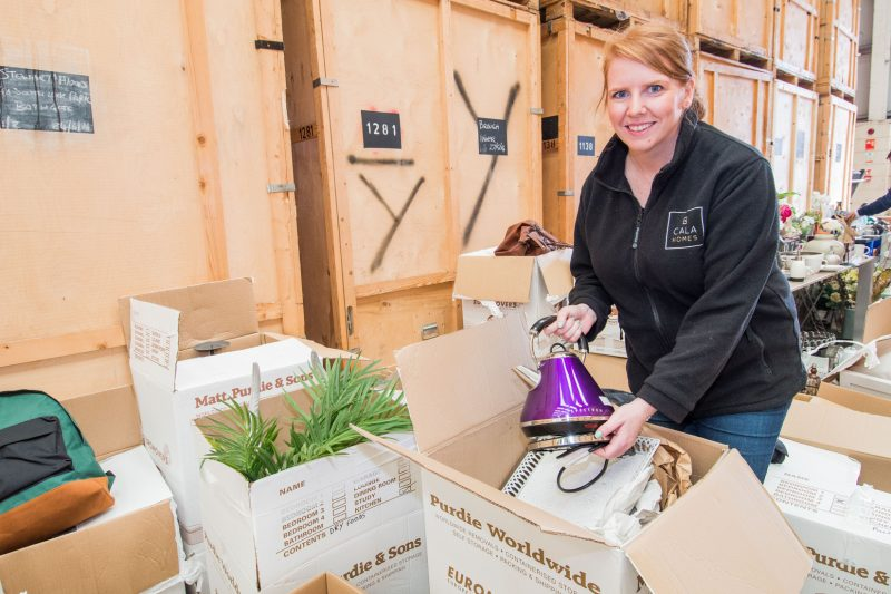 PR Photos of Claire McLoughlin, Marketing Assistant at CALA Homes (East) showing off some of the items that have been donated.