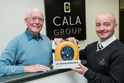 PR Photography of Site Manger Francis Cassidy presents the defib to Allan Murray Vice Chair of Currie Community council.