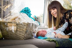 PR Photography shows New mother Louise Inglis playing with her baby Brodie on the sofa