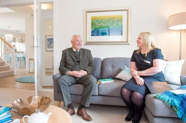 Councillor Ricky Henderson sits comfortably in the Kinleith Showhome with CALA Representative captured by PR Photography