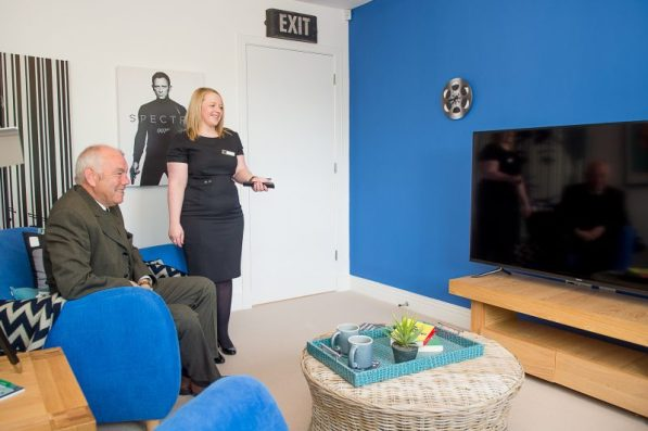 Councillor Ricky Henderson checks out what is on television at Kinleith Showhome with CALA Representative as shown by PR Photography