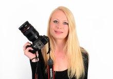 PR Photography Expert holding camera