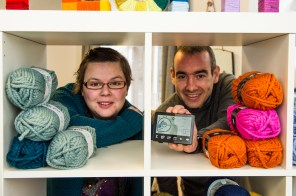 Roddy and Leona peek through yarn to show us the smart meter