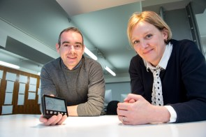 Roddy Hamilton and Lucy Richards pose with trusty smart meter