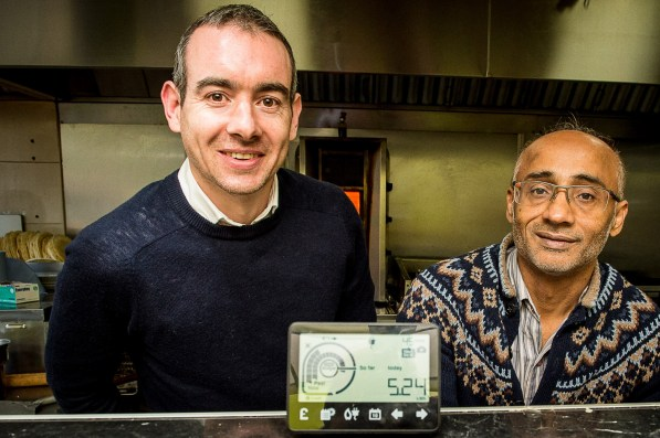 Roddy Hamilton and Farooq Siddique with the smart meter