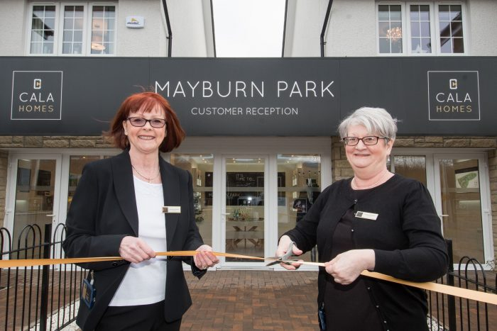 An image of two ladies cutting the ribbon in front of the new Mayburn Park showhomes as part of Property PR story