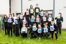 A picture of pupils at Woodlands Special School holding up letters that spell 'Thank You CALA Homes for Photography PR