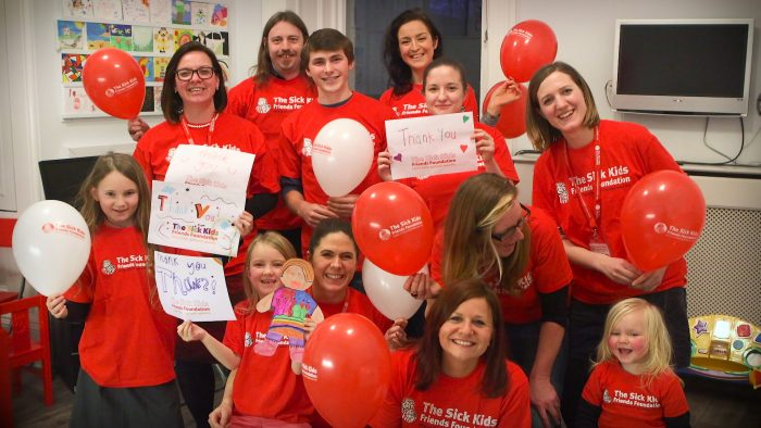 Photo of kids and ambassadors holding balloons as part of a Care PR story