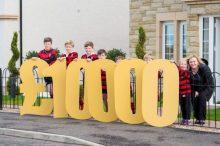Team members pose with bursary figures for Edinburgh PR story