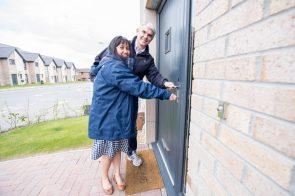 Robert and Jennifer unlock the door to their new home