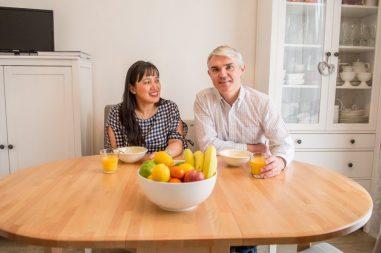 Robert and Jennifer enjoy breakfast at the table