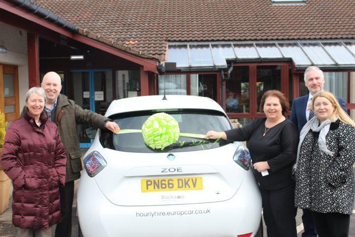 Blackwood team pose with E-car for Edinburgh PR Agency Story