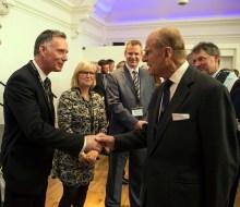 Public relations agency owner meets the Duke of Edinburgh