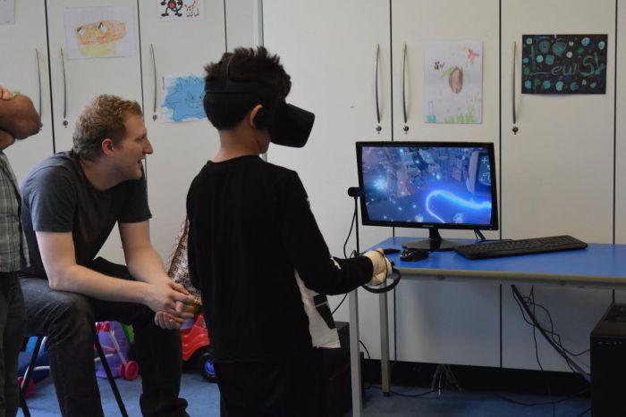 Ryan Ziggan (9) trials the virtual reality headset in ECHC - image for Charity PR