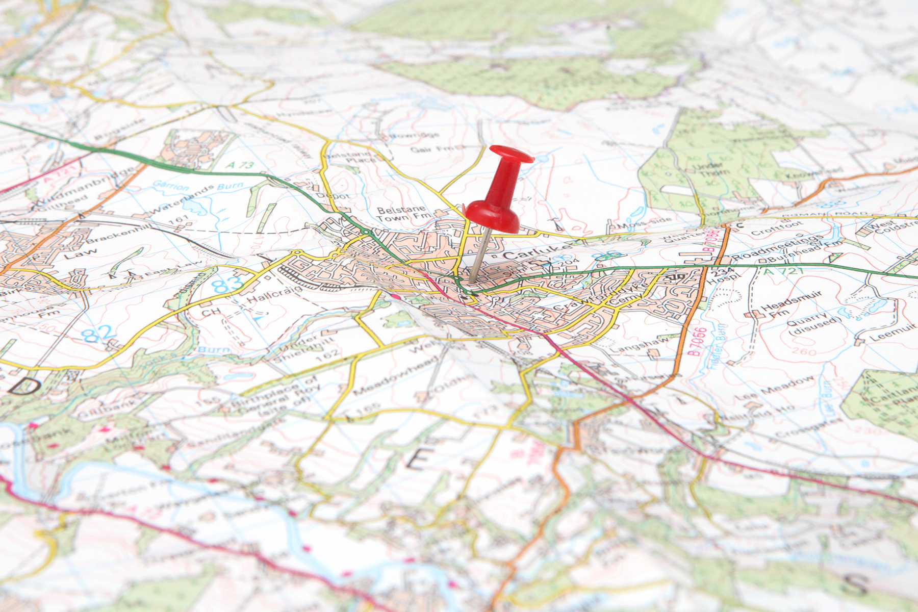 PR photograph of a map with a pin in it