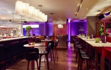 Hotel PR photograph of rear bar and banquettes in Tigerlily, Edinburgh