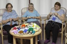"Care PR photograph of Bield tenants knitting ""The Trauma Teddies"" for Police Scotland 