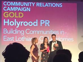 Gold PR award collected on stage by staff from award winning PR agency