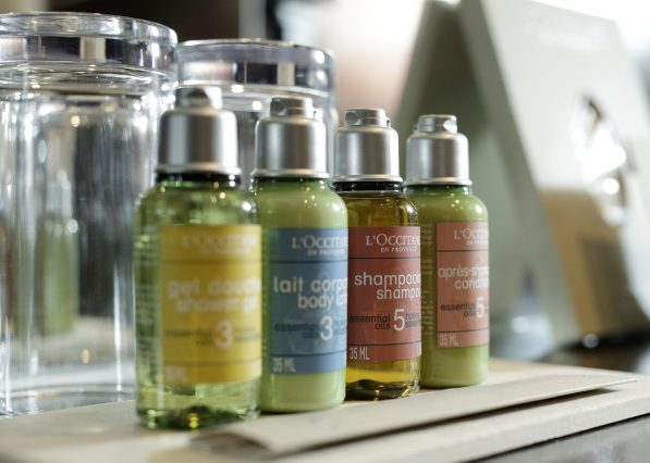 Hospitality PR photograph for Nira Caledonia - mini L'Occitane bottles of shampoo, shower gel, conditioner and body lotion