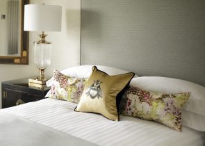 Hospitality PR photograph of luxury bedding and decorative pillows at Nira Caledonia