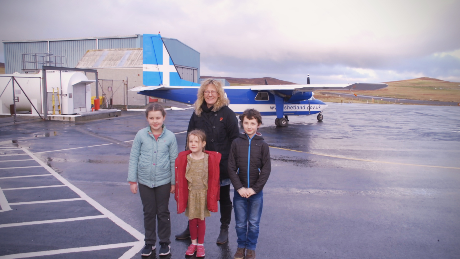 Fair Isle school children Grace Parnaby, 9 Freyja Parnaby, 6, and Lewis Wright-Stanners, 9 with head teacher Ruth Stout. Public Sector PR