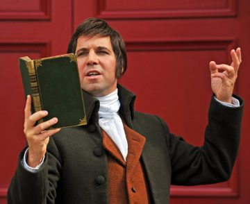 Rabbie Burns impersonator Chris Tait captured in PR photography with a rare first edition of Burns' poetry