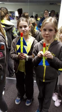 Two young Brownies show off their miniature creations made at an event visited by Edinburgh based Skyrora, shares tech PR agency
