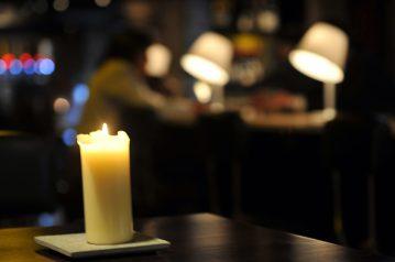 A candle is lit inside Edinburgh wine bar Divino Enoteca