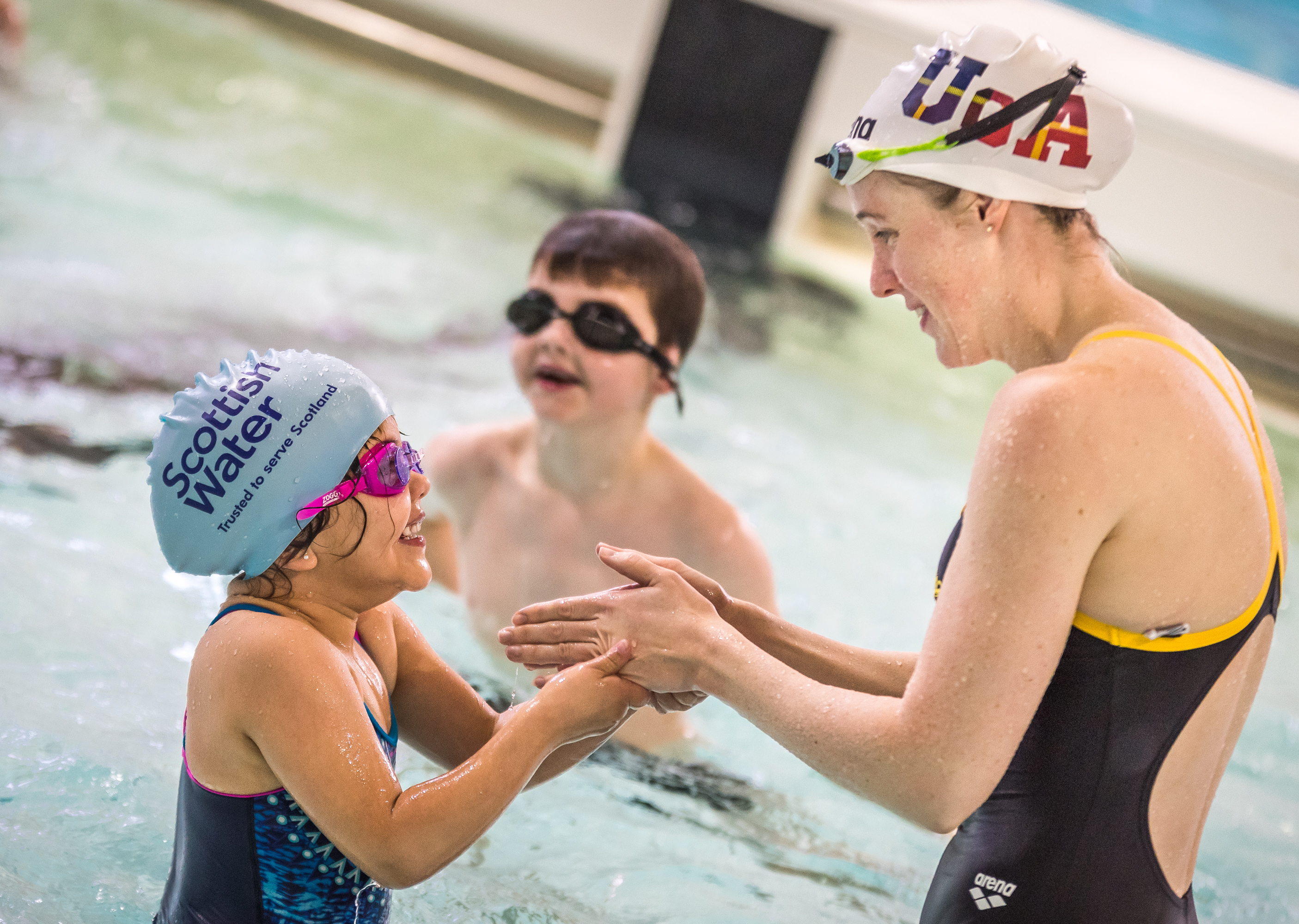 Triple Olympian Hannah Miley helps out at Learn to Swim programme