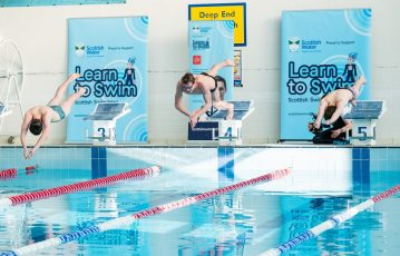 The PR photography shows youngsters taking a dive into a race with Duncan Scott as part of celebration of Learn To Swim campaign by public relations experts at Holyrood PR