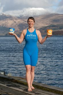 Jade Perry captured by Food and Drink PR Photography at Loch Lomond holding two tubs of Mackie's Ice Cream