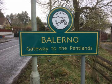 "Image shows Balerno's new green and yellow welcome signage, along with ""Gateway to the Pentlands"" - installed thanks to CALA Homes 